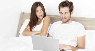 couple in bed on social media
